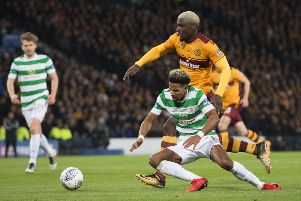 Scott Sinclair goes down under the attentions of Cedric Kipre. Picture: SNS