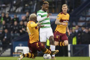 Motherwell's Cedric Kipre (left) challenges Celtic's Moussa Dembele. Picture: SNS