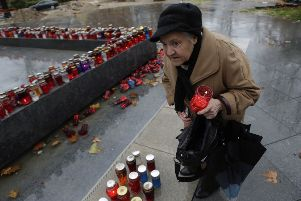A Bosnian Croat woman lights a candle in memory of Slobodan Praljak, in the southern Bosnian town of Mostar 140 kms south of Sarajevo. Picture: AP Photo/Amel Emric
