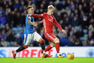 Aberdeen's Gary Mackay-Steven is challenged by Rangers' James Tavernier. Picture: PA