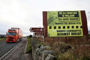 A poster calling for no hard border between North and South on the road between Newry and Dundalk. (Picture: AFP/Getty)