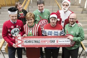 Back row, from the left: Childcare minister Maree Todd, Scottish Parliament Presiding Officer Ken Macintosh, Labour MSP Anas Sarwar and (front row, from the left) Lib Dem leader Willie Rennie, First Minister Nicola Sturgeon, Scottish Tory leader Ruth Davidson and Scottish Greens co-leader Patrick Harvey wear their Christmas jumpers for a good cause. (Picture: PA)