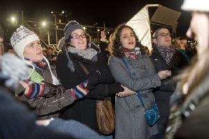 Revellers cross their arms and link hands while singing Auld Lang Syne, Picture: Ian Georgeson