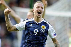Leigh Griffiths celebrates after scoring the second of his two goals against England. Picture: Michael Gillen