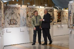 Author Alexander McCall Smith and Artist Andrew Crummy walk through some of the 160 panels.''Pic Neil Hanna