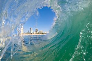 The kind of pipeline wave that makes the Gold Coast a paradise for surfers. Photograph: Brad Delaney/iStockphoto/Getty