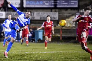 Chris Kane completes his hat-trick by scoring St Johnstone's fourth goal against Albion Rovers. Picture: SNS.