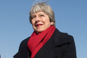Prime Minister Theresa May has described online intimidation and aggression as a threat to democracy. Picture: PA