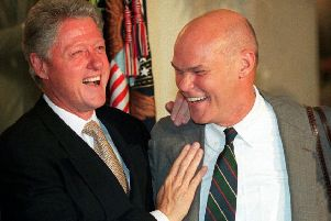 "US President Bill Clinton and friend James Carville, who is believed to have come up with the campaign slogan, ""It's the economy, stupid."" (Picture: AFP/Getty)"