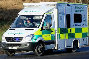 A woman has been arrested after an abusive note was lfet on an ambulance.