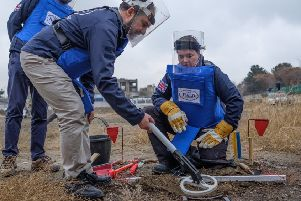 Scottish Conservative leader Ruth Davidson being given training on how to find, excavate and remove landmines by Halo charity staff (Picture: PA)
