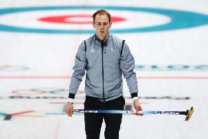 Kyle Smith looks on in the match with Switxerland at the Gangneung Curling Centre. Picture: Getty images