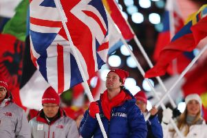 Great Britain flag bearer Billy Morgan walks during the closing ceremony of the Winter Olympics. Picture: Getty.