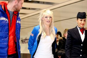 Elise Christie at Heathrow Airport sporting a protective boot. Picture: PA.