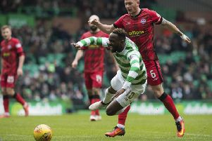 Moussa Dembele goes down under the challenge from Morton's Michael Doyle. Picture: SNS