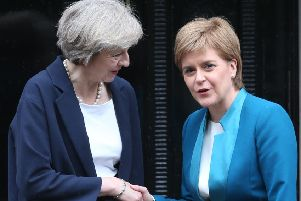 Nicola Sturgeon claims Theresa May's Government is attempt a 'power grab' of areas currently controlled by Brussels