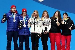 Brett Wild, far left, and Millie Knight on the podium with their silver medals. Picture: Getty.