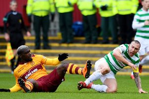 Cedric Kipre received a straight red card for kicking out at Scott Brown. Picture: SNS
