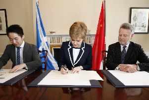 In Bute House Sturgeon signs up to the trade deal which was to cause her so much embarrassment. Picture: China Daily