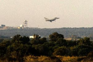 "A British military Typhoon aircraft lands at the Sovereign Base Area (SBA) of Akrotiri, a British overseas territory located ten kilometres west of the southern Cypriot port city of Limassol, following US, British and French strikes on Syria on April 14, 2018.  Syrian state media slammed Western strikes on Saturday as illegal and ""doomed to fail,"" after the US, Britain and France launched a joint operation against the Damascus government. Huge blasts were reported around the Syrian capital, moments after the three Western governments announced they were striking Syria's chemical weapons capabilities.  / AFP PHOTO / Iakovos HatzistavrouIAKOVOS HATZISTAVROU/AFP/Getty Images"