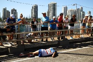 Callum Hawkins collapses with exhaustion near the end of the men's marathon in Gold Coast. Picture: Getty Images