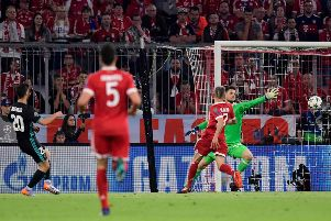 Marco Asensio fires the ball past Bayern Munich goalkeeper Sven Ulreich to clinch Real Madrid's victory in the Allianz Arena. Picture: AFP/Getty