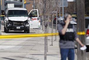 The van that was used to kill ten people in the Toronto attack is cordoned off by police. Picture: Cole Burston/Getty