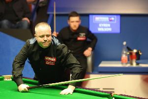 John Higgins surveys the table, while Kyren Wilson watches on, as the two battle for a place in the World Snooker Championship final. Picture: PA