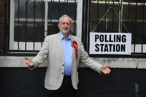 Jeremy Corbyn arrives to cast his vote at the polling station in Pakeman Primary School in Holloway, London, during the local council elections on Thursday. Picture: PA