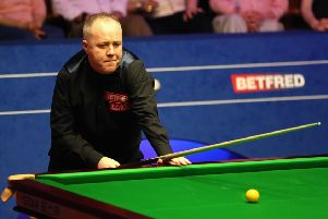 John Higgins spotted a fault in his game while watching himself on TV between sessions. Picture: Getty.