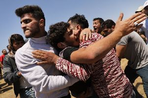 A wounded Palestinian man is rushed to an ambulance at the border fence with Israel as mass demonstrations continue in Gaza. Picture: Spencer Platt/Getty Images)