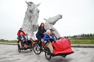 Public health minister Aileen Campbell takes Mary Duncan, 90, and Jim Taylor, 96,  for a spin at the Kelpies in Falkirk. Picture by Stewart Attwood