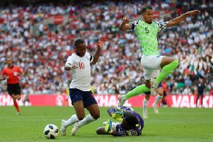 Raheem Sterling goes down inside the Nigeria penalty box, a dive which earned the England attacker a booking.  Photograph: Tim Goode/PA