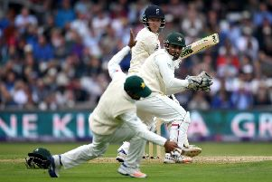 Dominic Bess guides the ball past wicketkeeper Sarfraz Ahmed and Asad Shafiq.  Photograph: Gareth Copley/Getty