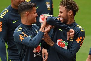 Brazil striker Neymar, right, larks about with Philippe Coutinho in training. Picture: Oli Scarff/AFP/Getty.