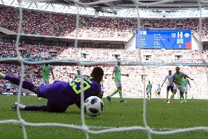 Harry Kane's effort squirms through the arms of Nigeria goalkeeper Francis Uzoho to put England 2-0 up at Wembley. Picture: PA.