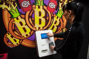 A customer uses a 'modest comission' Bitcoin vending machine in a CeX store in Glasgow. Picture: John Devlin