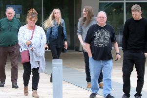 Members of Craig McLelland's grieving family leaving the High Court at Livingston after seeing his killer jailed for life. (Picture: Vic Rodrick)