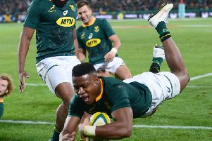 South African winger Aphiwe Dyantyi dives over during a thrilling Test match in Johannesburg.  Photograph: Getty Images