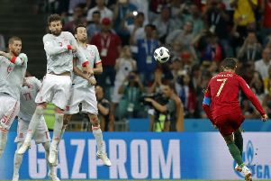 Cristiano Ronaldo curls the ball over the Spain wall to net his and Portugal's third goal in a dramatic finish at Fisht Stadium. Picture: AP