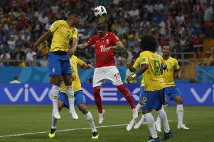 Steven Zuber heads home the equaliser for Switzerland. Picture: AP