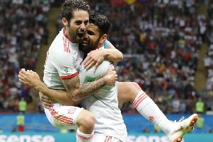 Diego Costa, right, celebrates with Spain team-mate Isco after scoring his side's second-half winner against Iran. Picture: AP