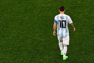 All alone: Lionel Messi has had nobody to support him, with Argentina's midfield being their weakest link. Picture: AFP/Getty.