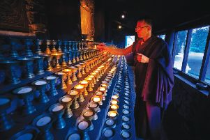 A monk in the Butterlamp House, Kagyu Samye Ling Tibetan Buddhist Centre, Eskdalemuir, Dumfries and Galloway'Picture Credit : Paul Tomkins / VisitScotland