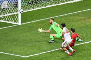 Portugal come within inches of elimination as Mehdi Taremi of Iran shoots just past Rui Patricio's goal. Picture: Getty.