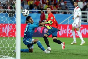Iago Aspas of Spain backheels a late equaliser past Monir El Kajoui of Morocco to earn Spain a 2-2 draw  and secure top spot in Group B. Picture: Getty.