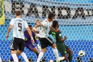 Marcus Rojo provides Argentina with a late winner to secure second place in Group D. Picture: Getty.