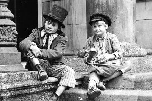 At 15, the Oliver Twist-like Cameron Wyllie used to come home with pockets full of coins, which were gifted by doting female customers, rather than pick-pocketed (Picture: Getty)