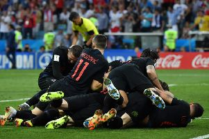 The Croatian players celebrate winning their penalty shootout against Russia. Picture: Nelson Almeida/AFP/Getty