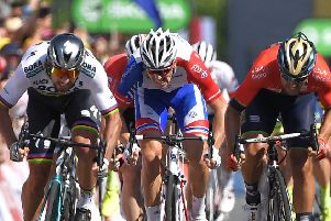 Peter Sagan, left, holds on to win stage two of the Tour de France ahead of Sonny Colbrelli, far right, and Arnaud Demare, centre. Picture: AFP/Getty Images